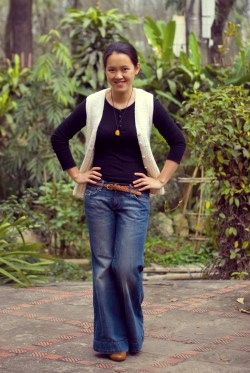 black tee white sweater vest wide-leg jeans by 14 shades of grey
