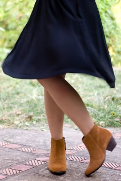 black pleated skirt brown booties by 14 shades of grey