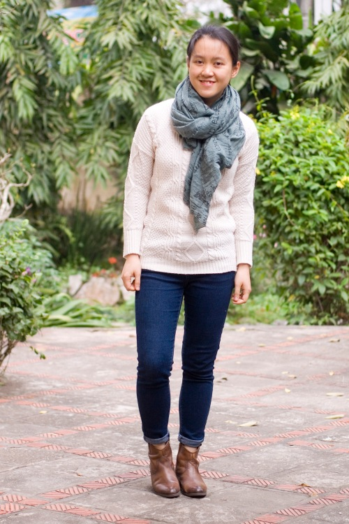 white sweater green scarf blue jeans brown booties by 14 shades of grey